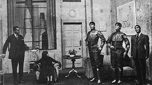 A scene in the play, showing three robots.